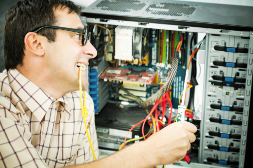 Male geek fixing his computer.