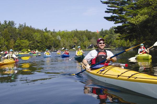 participants raise money and paddle to support the summer camp