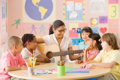 Teacher singing with children