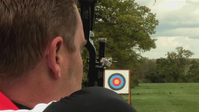 Man using sight on a bow