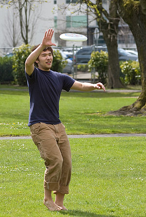 one handed Frisbee catch