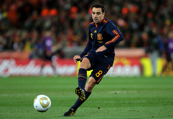 Xavi Hernandez playing a short pass