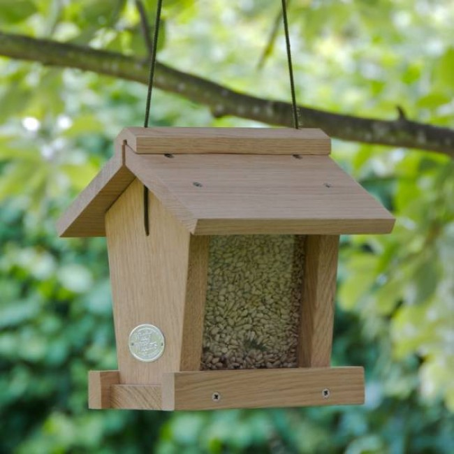 Making bird feeders bing images for How to make homemade bird houses