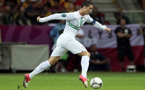 Cristiano Ronaldo running with a soccer ball