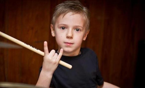 A child with a drum stick