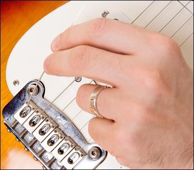 Pulling strings from the guitar