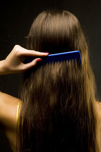 Girl using wide comb