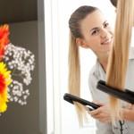 Woman using flat iron