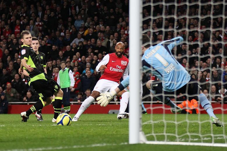 Striker scoring a goal