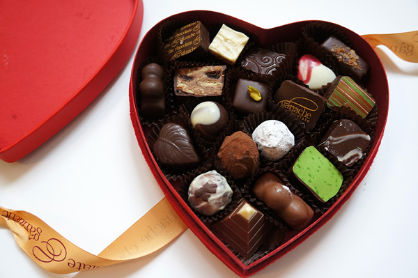 a heart-shaped chocolate box with chocolate in it