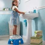 Child brushing teeth on stool