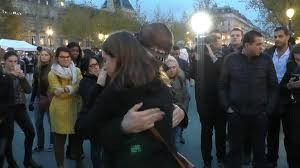 muslim man in Paris gets hugs